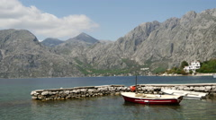 Boats in a small harbour in Kotor Bay Montenegro Stock Footage