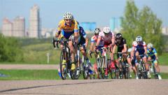 Bicycle Race. A group of cyclists racing at high speed on the track. - stock footage