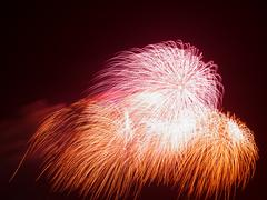 Beautiful colorful red and orange fireworks Stock Photos