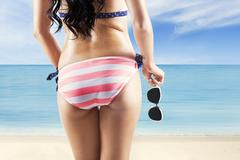 Rear view of woman with sunglasses Stock Photos