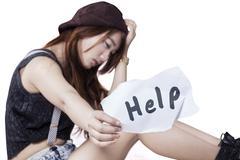 Sad teen girl need help - stock photo