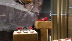Quick look inside luxury boutique shop-window with red woman's shoes Stock Footage