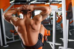 Back view of man doing abdominal crunches Stock Photos