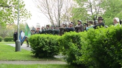 commemorate the victims of World War II at the cemetery - soldiers salute - stock footage
