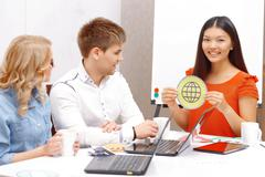 Young team working on new apps - stock photo