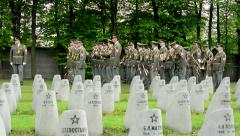Cemetery - gravestones - World War II and group of military musicians Stock Footage