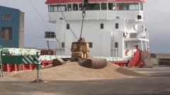 Crane by the dockside loading grain. Stock Footage