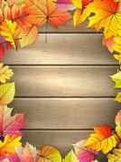 Wooden planks with autumn leaves. EPS 10 Stock Illustration