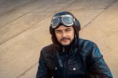 Retro Pilot Portrait with Glasses and Vintage Helmet - stock photo