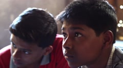 Indian boys practice drawing panning shot 2 Stock Footage