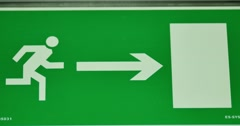Emergency exit sign going out of focus and comes into focus again - stock footage