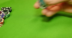 4K footage of a gambler playing with his chips Stock Footage