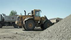 Loaded tipper leaving, bulldozer collect sand with shovel, groundwork, roadworks - stock footage