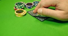 A black jack player takes peeps his cards and reveals the black jack he has got - stock footage