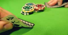 Two players playing black jack, they put some chips on the table - stock footage