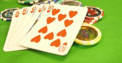 A player raises the bet and puts a lot of chips on the table Stock Footage