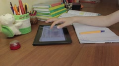 Teenager using a digital tablet work on a homework assignment. - stock footage