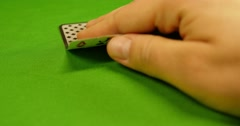 A player has got a black jack,raises the bet and reveals his cards - stock footage