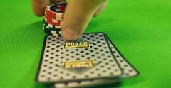 A player takes his cards, bets, waits the others to bet and reveals his cards Stock Footage