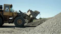 Stock Video Footage of Excavator collect gravel and sand, then loading dump truck, bulldozer, roadwork.