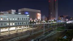 High angle time lapse looking South from Shinjuku station at night Stock Footage