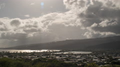Zoom out time lapse as clouds pass over town on east side of Oahu, Hawaii - stock footage