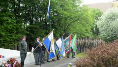 Stock Video Footage of commemorate the victims of World War II at the cemetery - soldiers hold flags