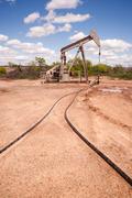 Texas Oil Pump Jack Fracking Crude Extraction Machine Stock Photos