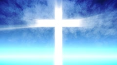 Cross of Christ ray beams and blue sky background - stock footage