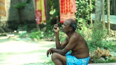 old man in indian village sitting and contemplating - stock footage