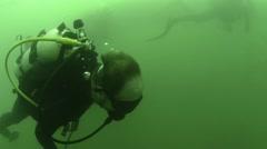 USS Arizona underwater footage cameraman Stock Footage