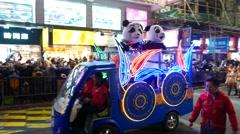 Dummy panda costumes at New Year parade, tracking shot Stock Footage
