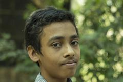 Handsome young man  in a village in India 2 - stock photo