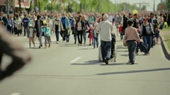 A disabled person and City Street Crowd Stock Footage