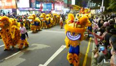 Dragon costumes at parade procession on night street, with sound Stock Footage