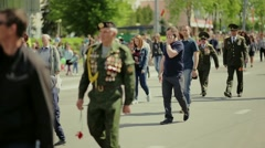 Military veterans of war walking in the city Stock Footage