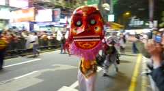 Big scary mask costume at night parade, festival procession Stock Footage