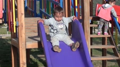 Child slides and falls down - stock footage