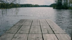 Old pier on a lake Stock Footage