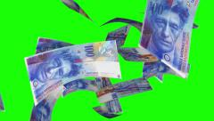 Falling Swiss Francs (Loop on Greenscreen) Stock Footage