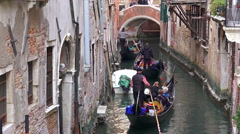 4K gondolas in line at narrow chanel Stock Footage