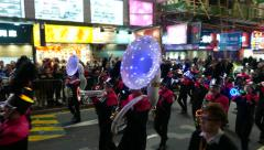 Wind instruments orchestra marching on night street, parade procession Stock Footage