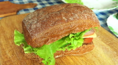Delicious Sandwich of Rye Bread with Tomatoes, Lettuce, Sturgeon, Cheese Stock Footage