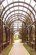 archway in garden - stock photo