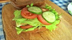 Delicious Sandwich of Rye Bread on a table. 4K Stock Footage