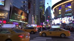 Road traffic at the intersection 42th St & 7 Ave at night. NYC. Timelapse Stock Footage