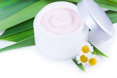 Organic skincare creams with camomile - stock photo