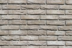 Background of grey brick wall pattern texture. Stock Photos