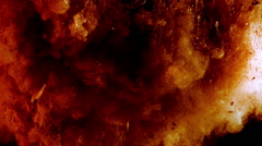 Ash and red glowing particles like in a real explosion, on black background Stock Footage