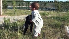 Toddler spanks a goatling 3 - stock footage